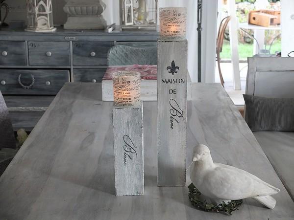 Zwei individuelle Kerzenständer mit Windlicht